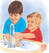 Two boys washing hands in sink.